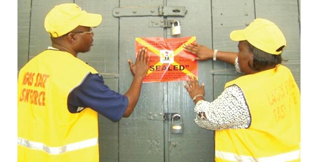 LIRS officials sealing off an office over tax evasion