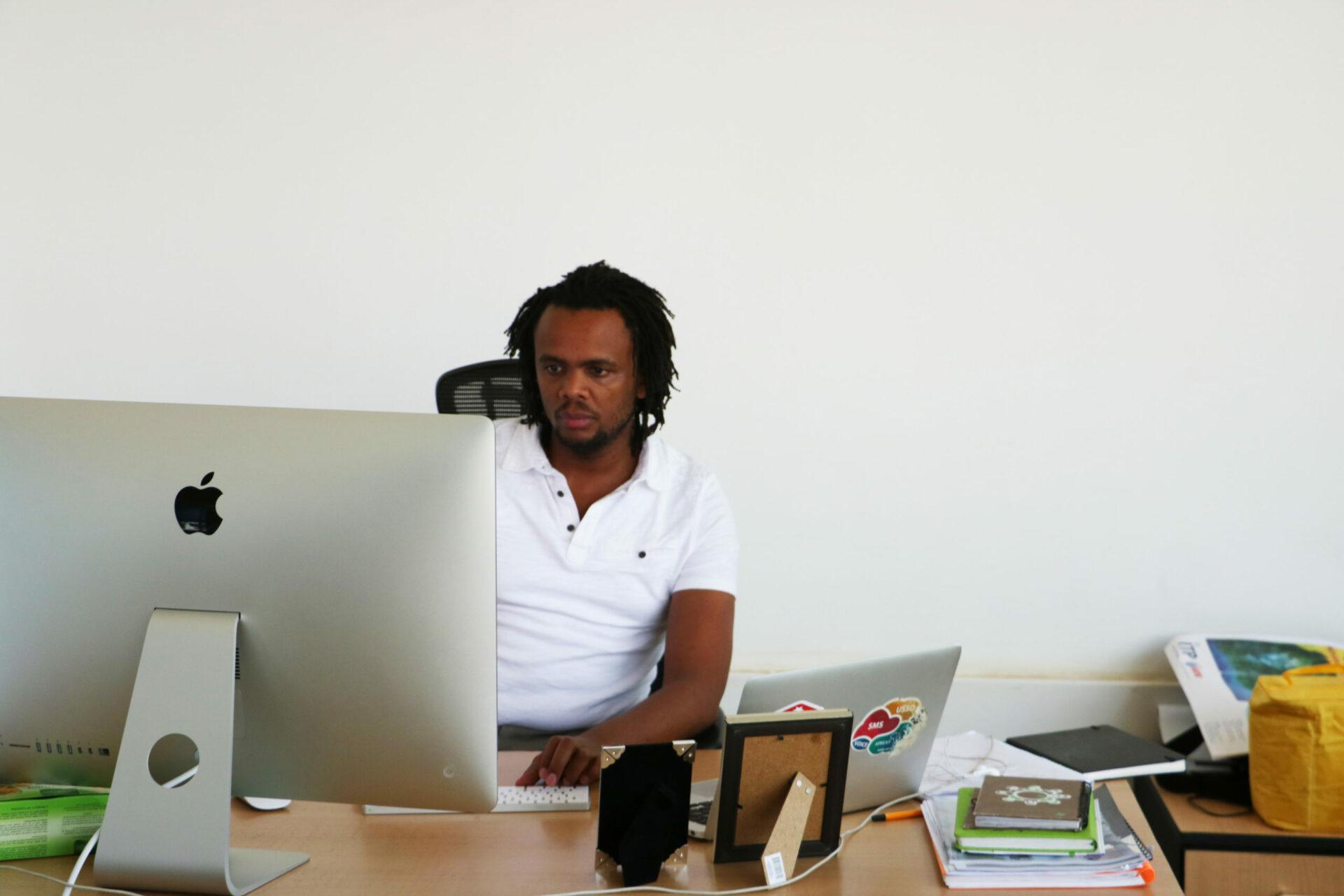 Sam at Desk scaled