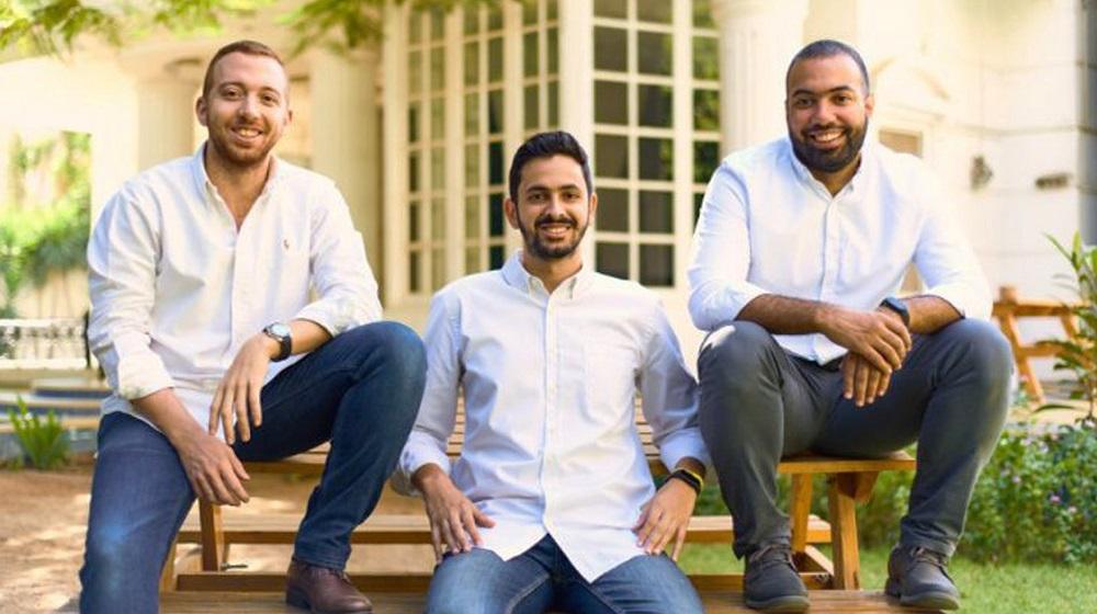 Three men sitting on a bench