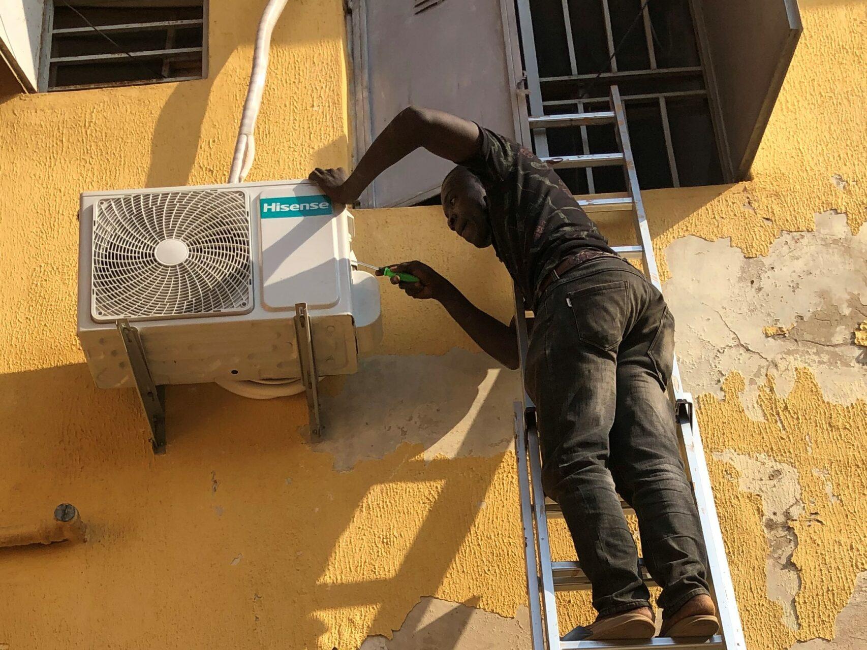 Man Instalilng an AC